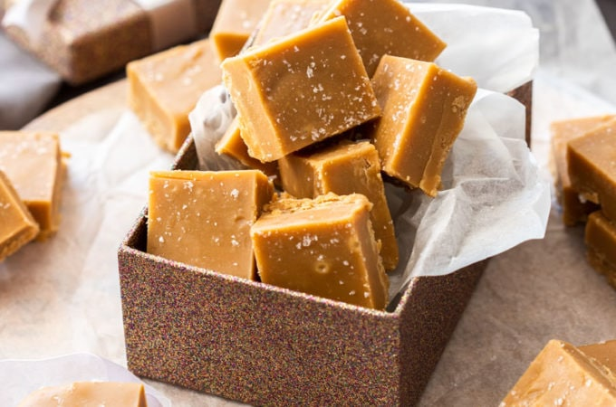 A bronze gift box filled with squares of salted caramel fudge