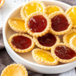 This Jam Filled Cookies recipe is super easy. Using my standard sugar cookie dough, these are cooked in muffin tins and have a jammy centre. #jamfilled #cookies