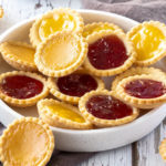 This Jam Filled Cookies recipe is super easy. Using my standard sugar cookie dough, these are cooked in muffin tins and have a jammy centre.