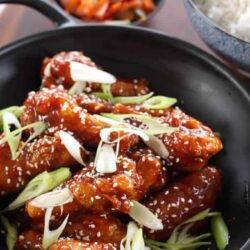 Korean Fried Chicken Wings are chicken wings fried until crispy, then slathered in a thick, sweet and spicy sauce.