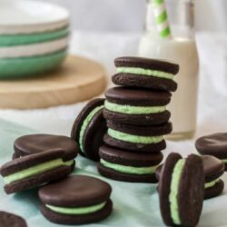 Easy to make, crisp dark chocolate cookies filled with a mint buttercream. These Chocolate Peppermint Cookies make a fun afternoon snack.