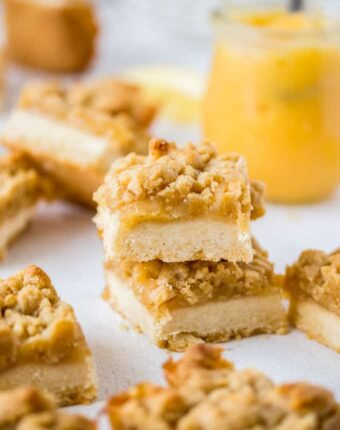 This Lemon Crumble Slice is zesty and bright and one of the most delicious lemon curd desserts. With a shortbread base and crunchy crumble topping, this lemon slice is easy to make too.