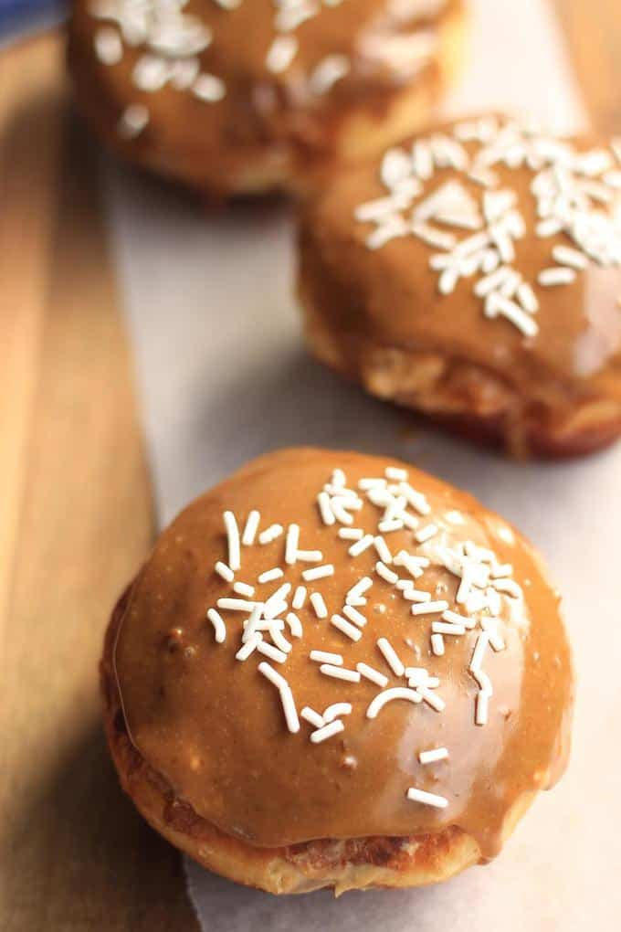 Caramel Doughnuts with Brown Sugar Custard by Sugar Salt Magic. Soft and fluffy doughnuts with a sweet caramel icing and filled with custard