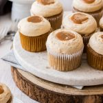 A view of 9 cinnamon cupcakes on a plate