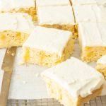 Slices of lemon poke cake on a cooking rack