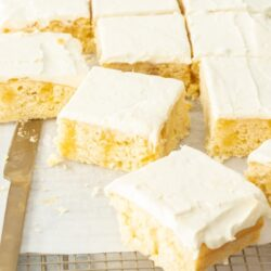 Slices of lemon poke cake on a cooking rack