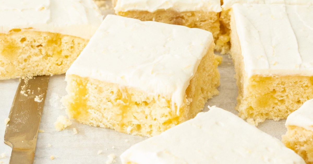 Very closeup shot of a slice of lemon poke cake