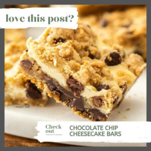 Closeup of a chocolate chip cheesecake bar on a white marble platter