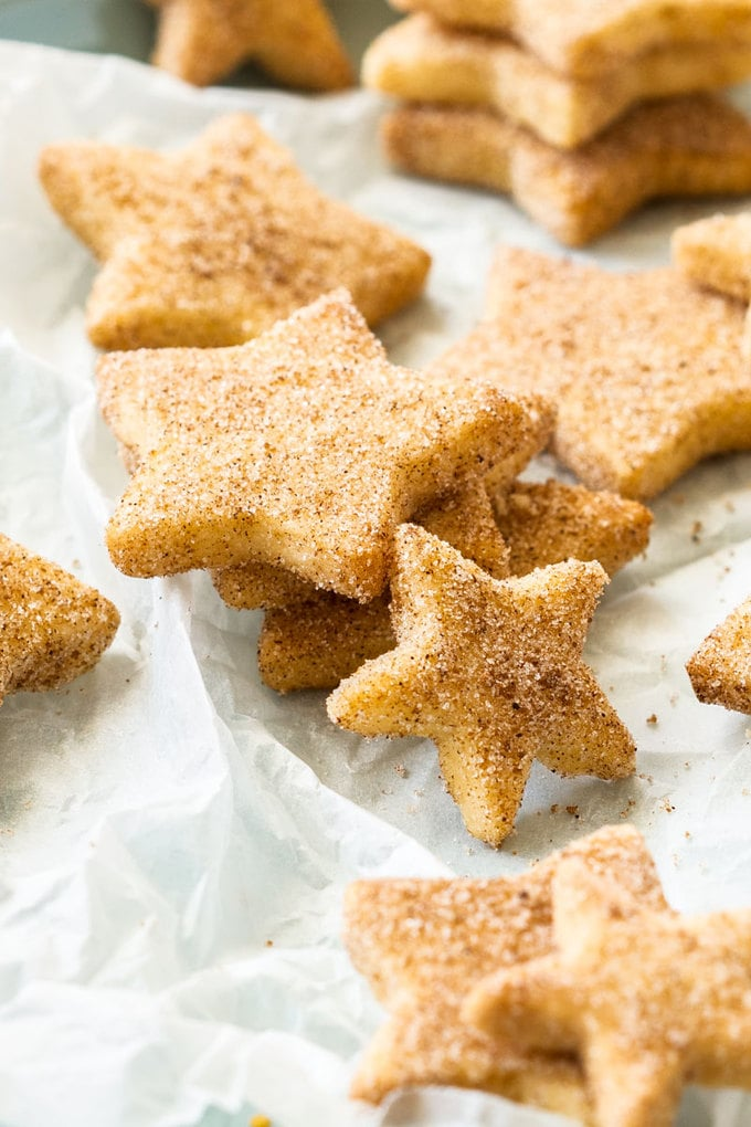 Closeup of a stack of star-shaped shortbread cookies on a sheet of crumpled baking paper