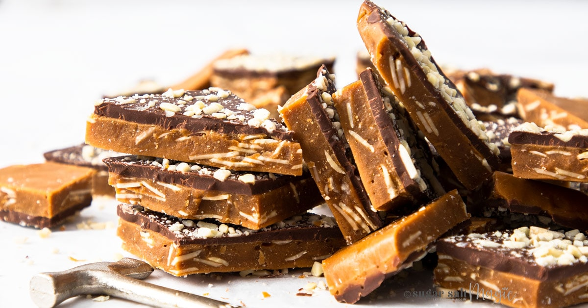 A pile of almond roca buttercrunch toffee covered in chocolate and almonds