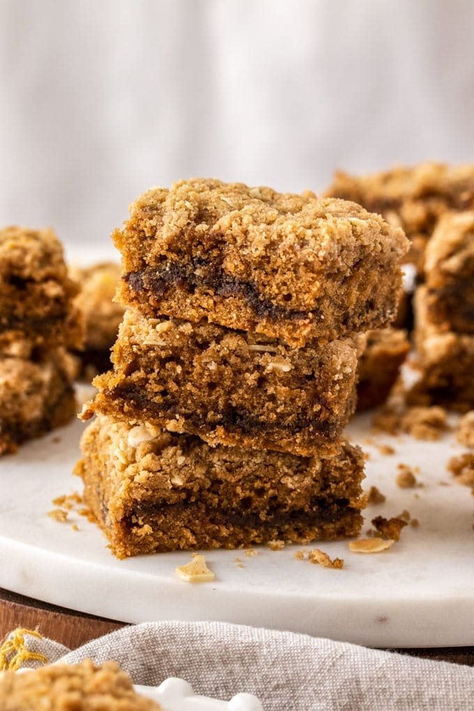 A stack of 3 pieces of crumb cake