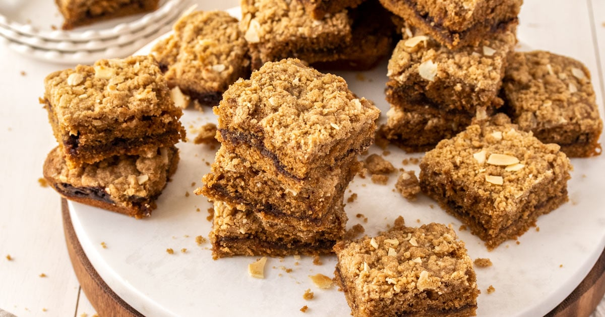 A stack of 3 pieces of crumb cake surrounded by more