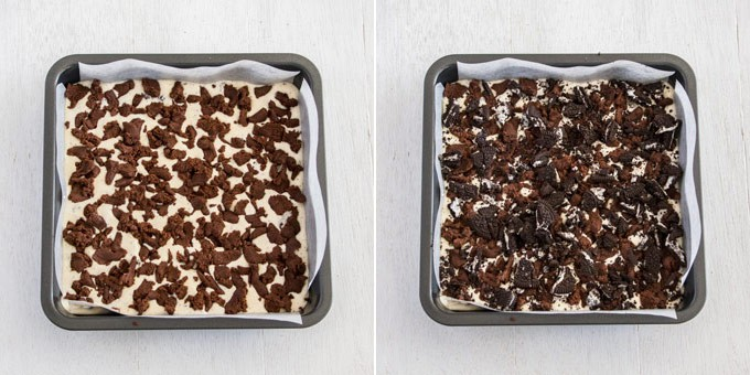 Cookie dough and oreo pieces scattered over a creamy filling in a square tin