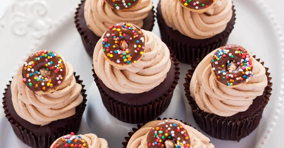 Chocolate Doughnut Cupcakes are a cinnamon cupcake, topped with a chocolate glaze, then whipped milk chocolate buttercream frosting. Divine!
