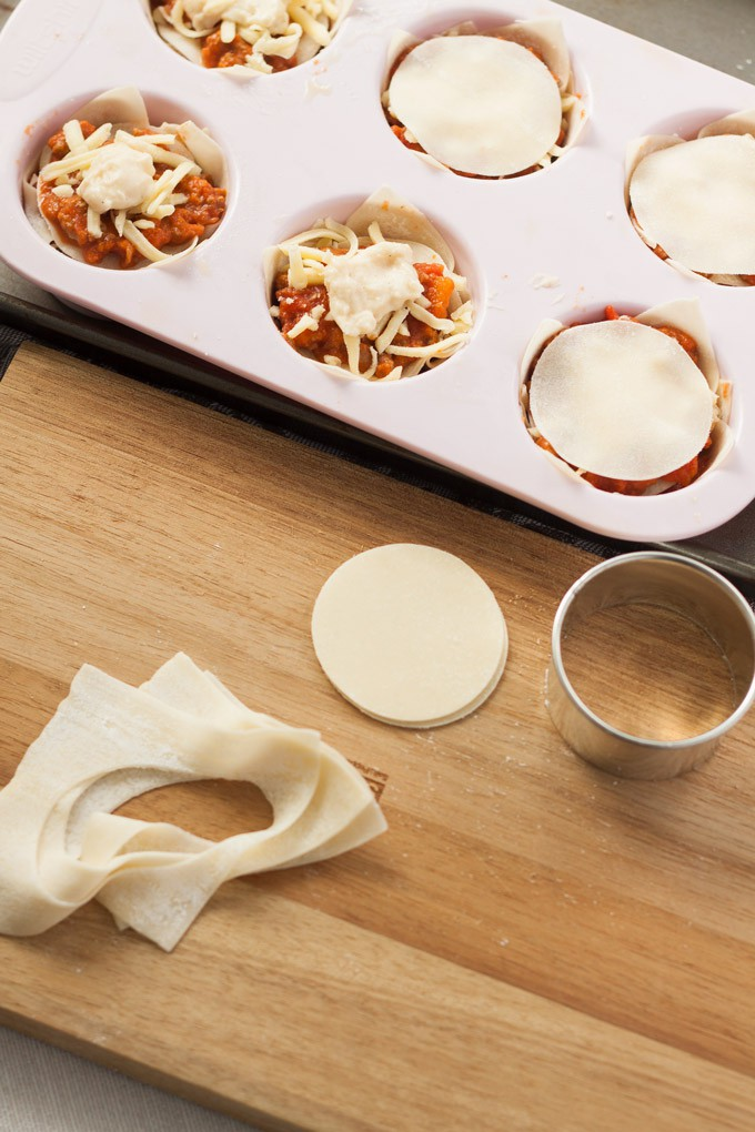 Making mini lasagna cupcakes in a muffin tin with wonton wrappers
