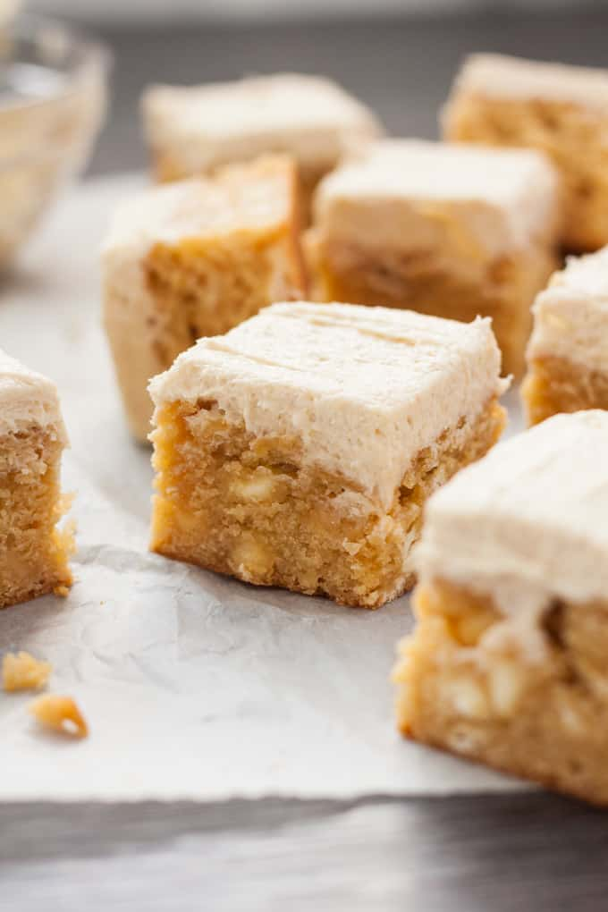 A batch of white chocolate blondies with the camera zoomed in on the middle one.