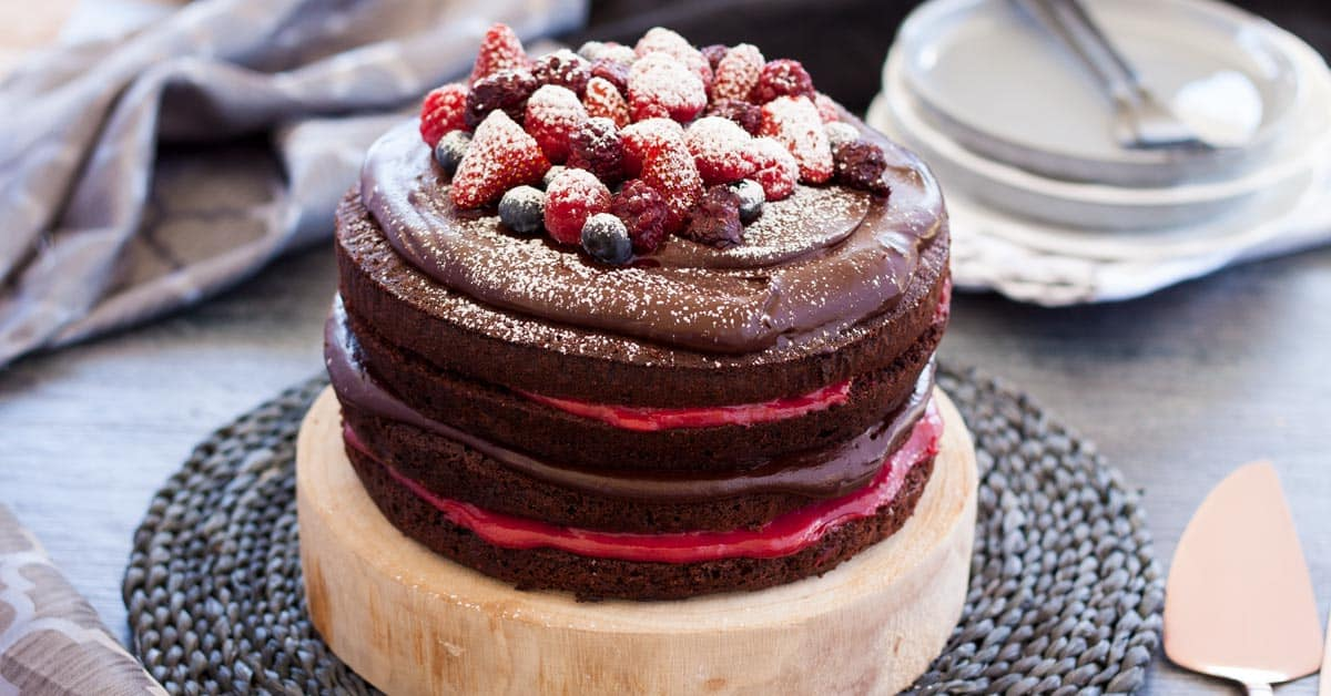 This Blackberry Chocolate Cake is 4 layers of soft and fluffy chocolate cake with chocolate ganache and Homemade Blackberry Curd. Just the perfect cake for a celebration.