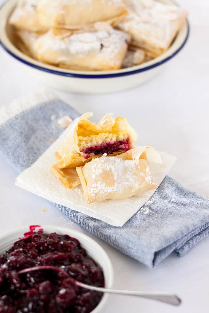 Almond Cherry Hand Pies are almond cheesecake and easy homemade cherry jam, all wrapped up in filo pastry and baked. #handpies #cherries