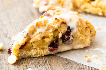 a cranberry scone on a wooden board
