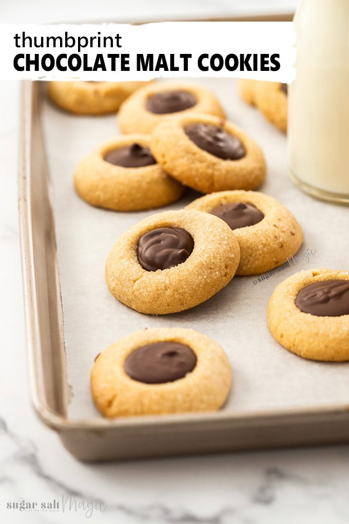 Malted Chocolate Thumbprint Cookies. Crunchy cookies flavoured with malted milk and filled with melted chocolate. #malt #chocolate