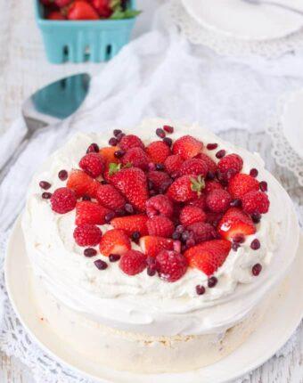 Perfect homemade Pavlova perched atop a creamy, homemade Raspberry Ice Cream base make this Raspberry Pavlova Ice Cream Cake a very special dessert. #pavlovaicecream #australiadayfood