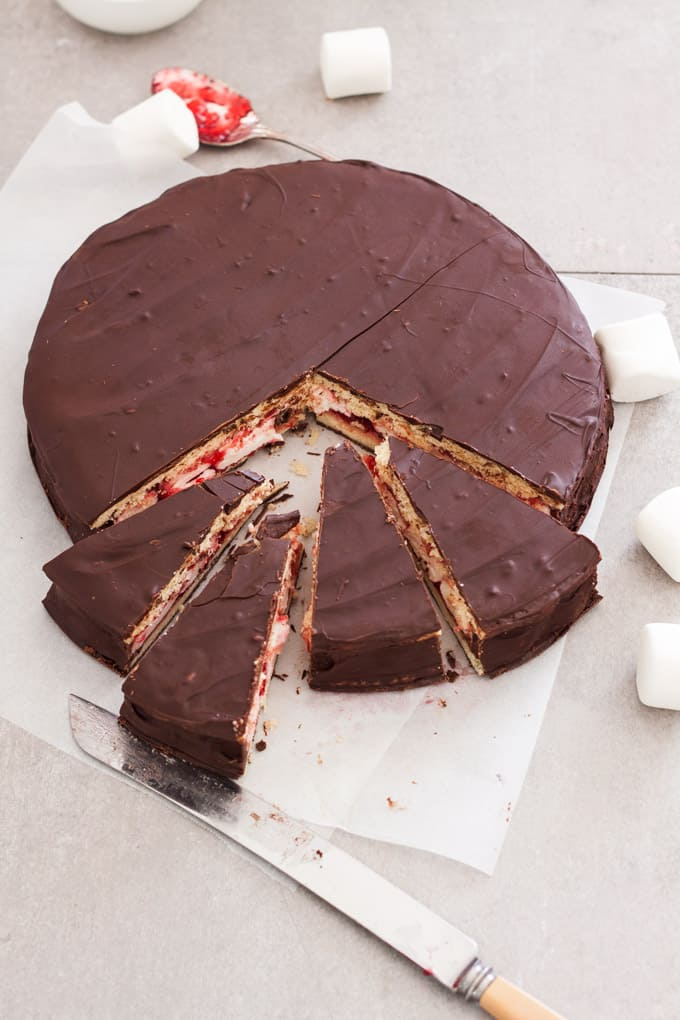 This Giant Homemade Wagon Wheel Biscuit is just like the wagon wheels you grew up with but bigger. A delicious combination of biscuit, marshmallow and raspberry jam all smothered in dark chocolate.