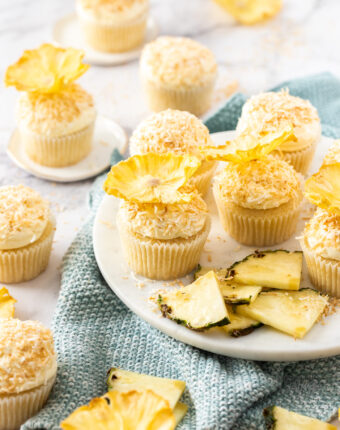 A batch of cupcakes with pineapple flowers on top