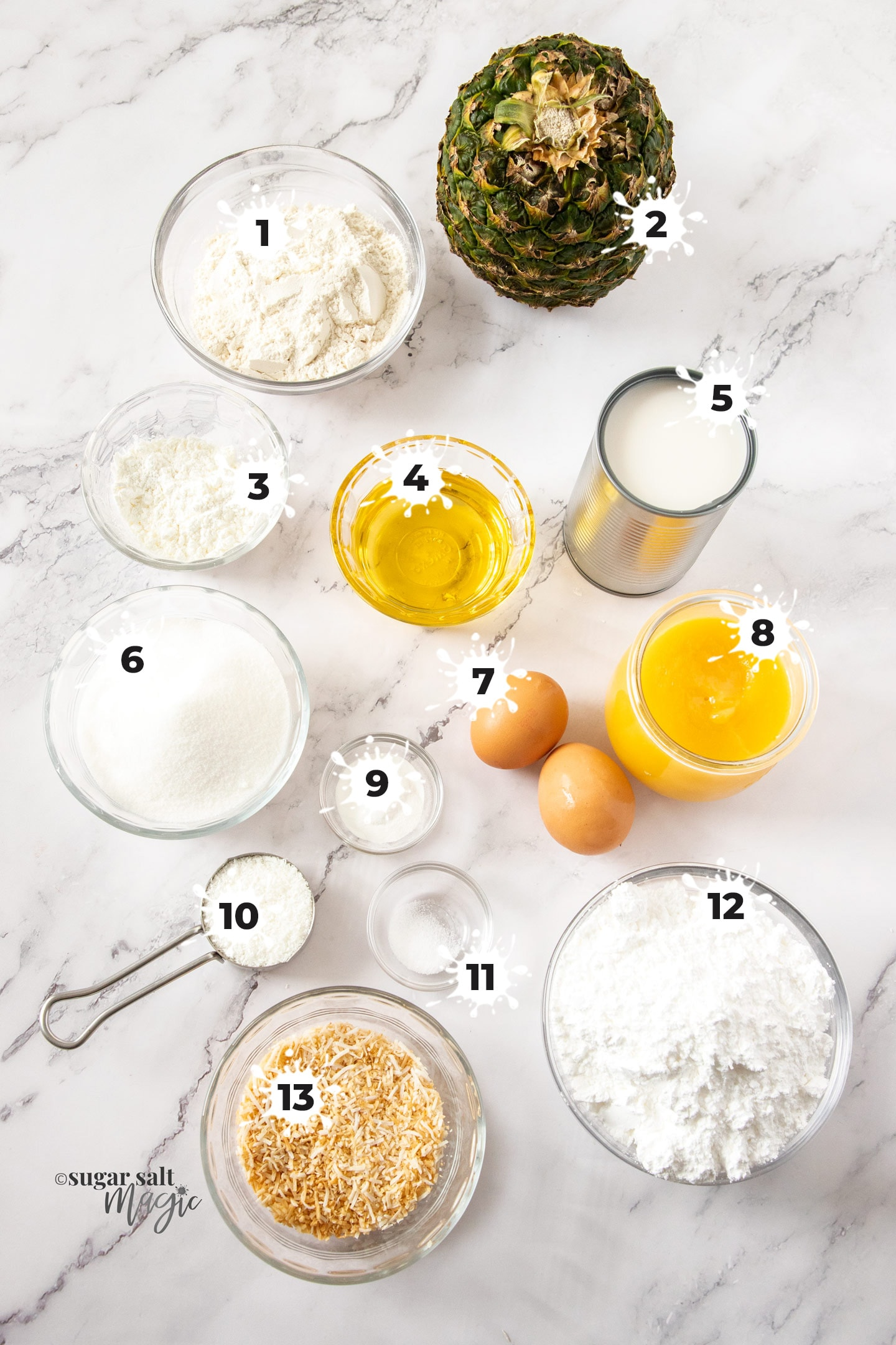 Ingredients for pineapple coconut cupcakes on a marble surface