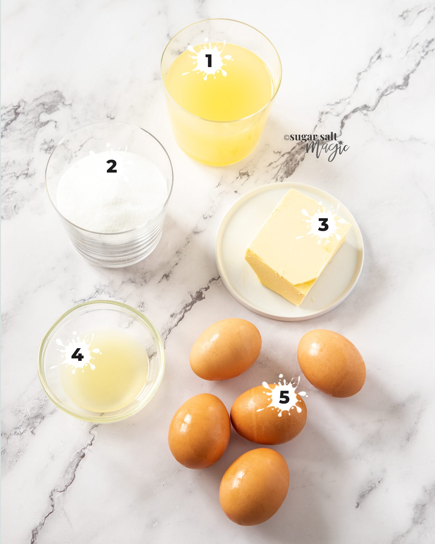 Ingredients for pineapple curd on a marble surface