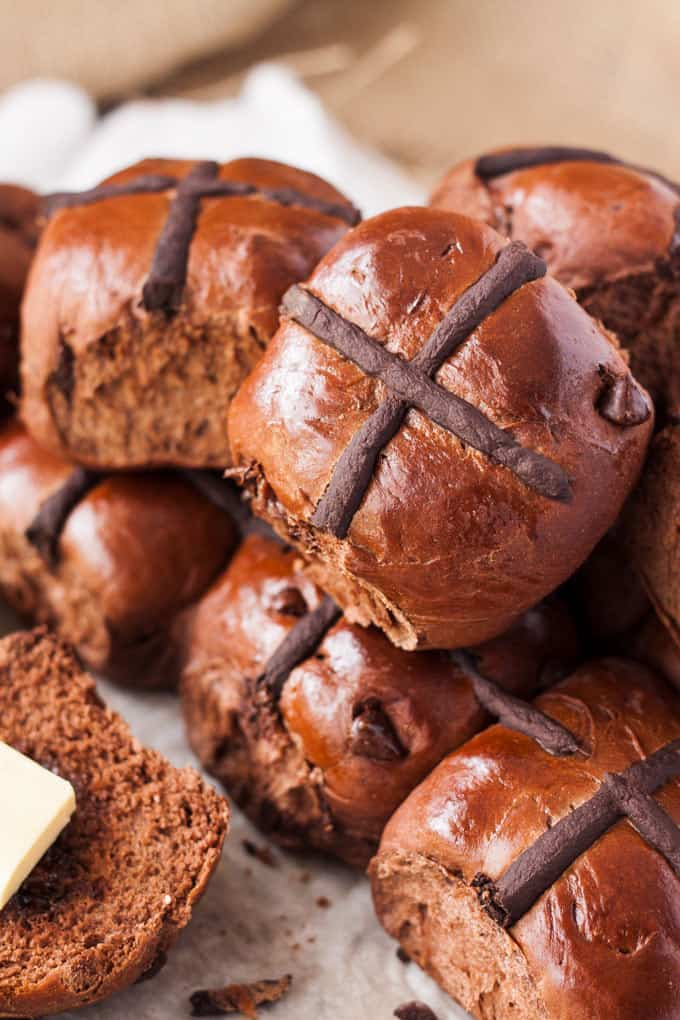 Making hot cross buns is incredibly easy with this Chocolate Hot Cross Buns recipe. Filled with chocolate chips plus cocoa in the dough, your family will be coming back for more.
