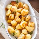 Crispy and golden on the outside, soft and fluffy in the middle - this is how to make Perfect Roast Potatoes #sugarsaltmagic #roastpotatoes #perfectroastpotatoes #easyroastpotatoes #ovenroasted #potatoes #roastpotatorecipe #crispyroastpotatoes