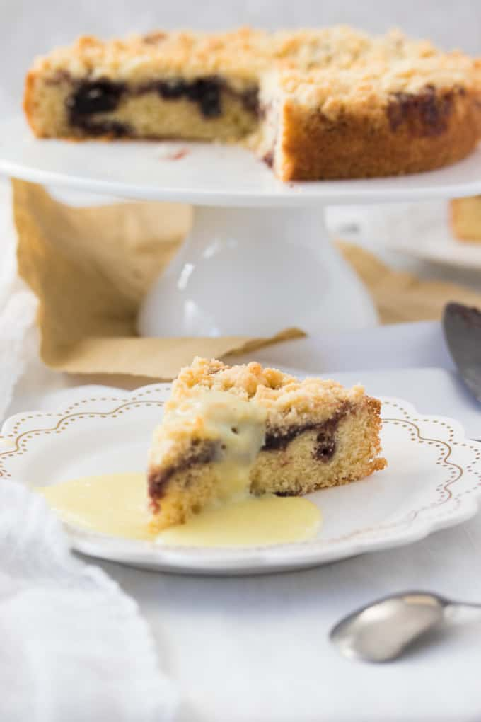 This Easy Cherry Cake with Crumble Topping is a delightful afternoon tea cake topped with cherry jam and a crunch streusel topping.