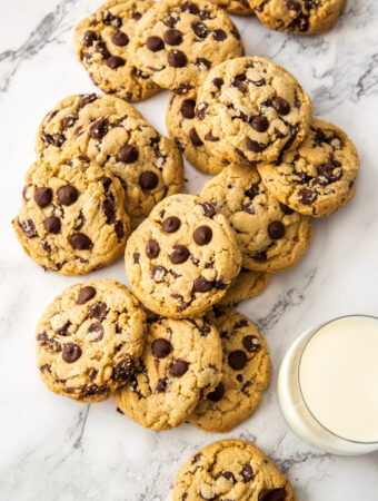 A pile of chocolate chip cookies on a marble bench top