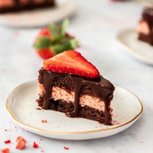 These Strawberry and Chocolate Petit Fours are easy to make chocolate cake filled with strawberry buttercream and topped with chocolate ganache. A cute sweet treat for Mother's Day, a birthday or afternoon tea.