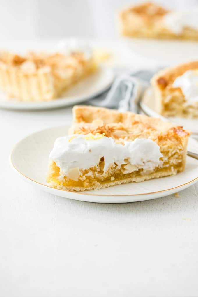 This gorgeous Lemon Coconut Frangipane Tart is a perfect coconut and almond frangipane filling on top of vegan lemon curd and inside a vegan tart shell. That's right, this lemon tart just happens to be vegan.