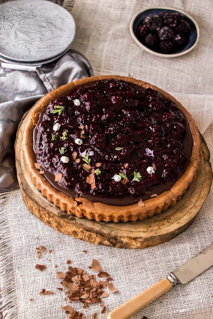 This Baked Chocolate Cheesecake with Blackberry Compote is an easy chocolate cheesecake recipe that's tastes sublime and is simple to make. Tangy, creamy and totally melt in your mouth.