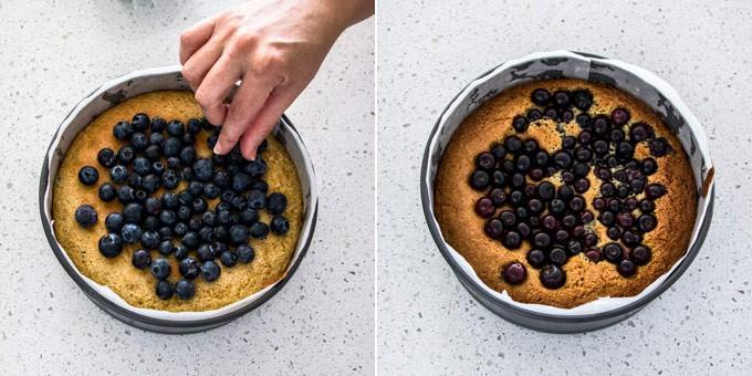 Adding blueberries to blueberry cake