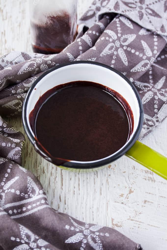 A small pot of chocolate sauce.