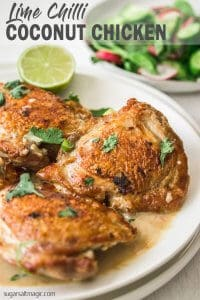This Lime Chilli Coconut Chicken is one of those easy chicken dinners that tastes amazing and takes 30 minutes or less. Chicken pieces with a golden, crispy skin in a coconut milk sauce.