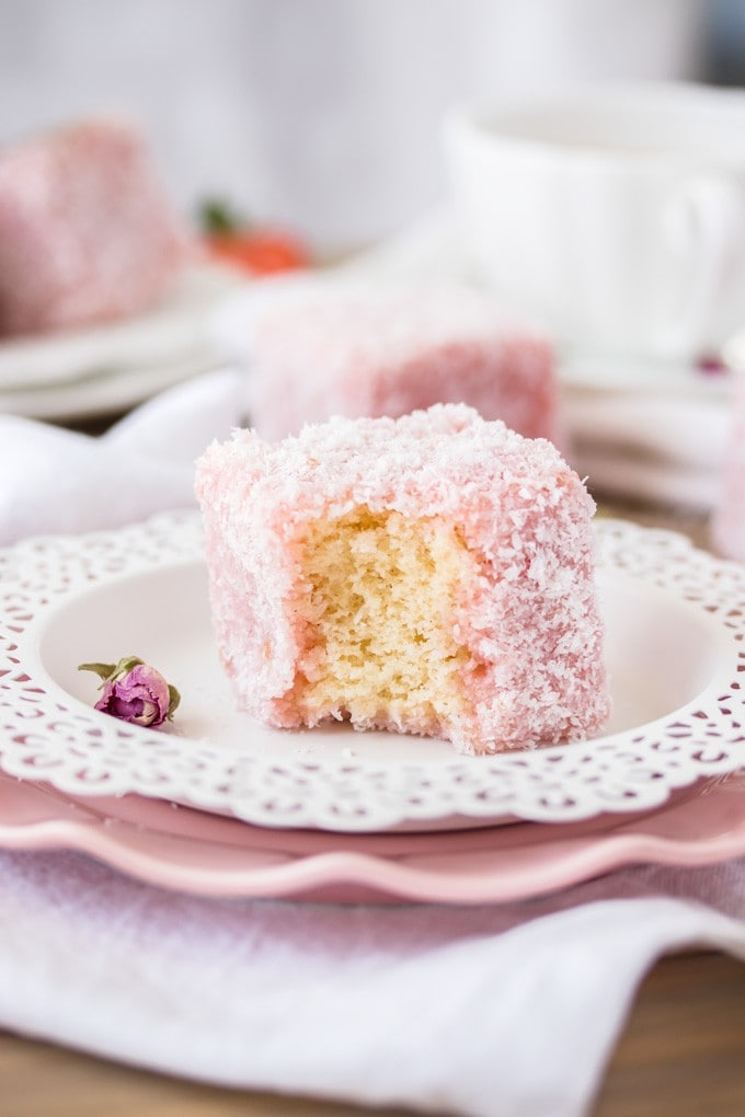 This Rose Strawberry Lamington recipe is a lovely twist on the classic Aussie Lamington. Pink lamingtons with a fluffy sponge centre and a homemade rose and strawberry jelly.