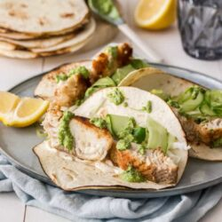 These Easy Fish Tacos will become a family favourite. Pan fried fish tacos, dressed in a pumpkin seed pesto are flavourful and ready in under 30 minutes.
