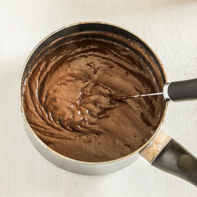 A saucepan of finished chocolate custard