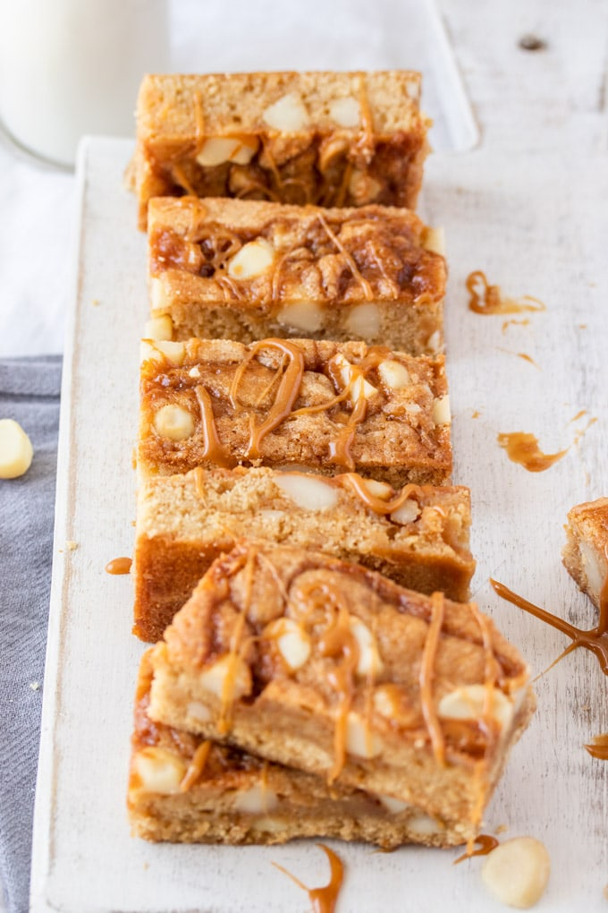 Caramel blondies lined up on a white board