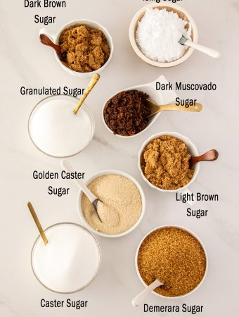 A graphic showing 8 different types of sugar in bowls