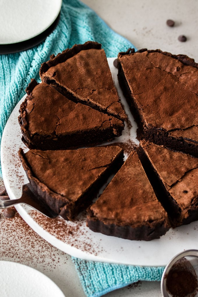 Overhead shot of a brownie pie cut into slices
