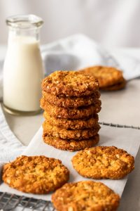 A stack of Anzac Biscuits on a wire rack