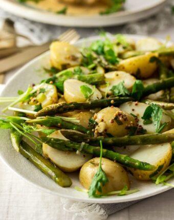 close up shot of warm potato asparagus salad