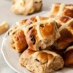 Surely nothing says Easter quite like Hot Cross Buns and they're easier than you might think. This easy Hot Cross Buns recipe, filled with white chocolate chips and dried cranberries is the perfect thing for Easter brunch.
