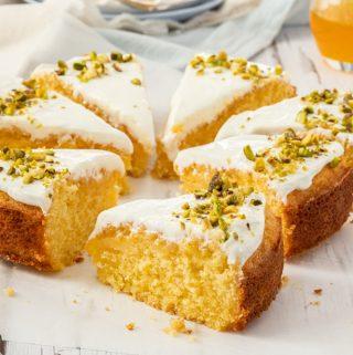 Closeup of a slice of Greek Orange Semolina Cake with more slices surrounding it