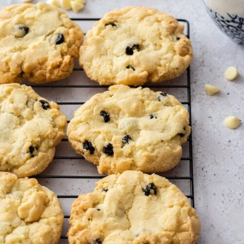 6 cookies sitting on a cooling rack on a grey surface